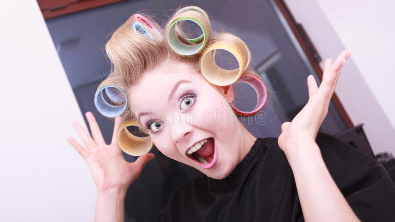 Download Funny Cheerful Blond Girl Hair Curlers Rollers By Hairdresser In Salon Stock Photo - Image of colorful, roll: 39507806