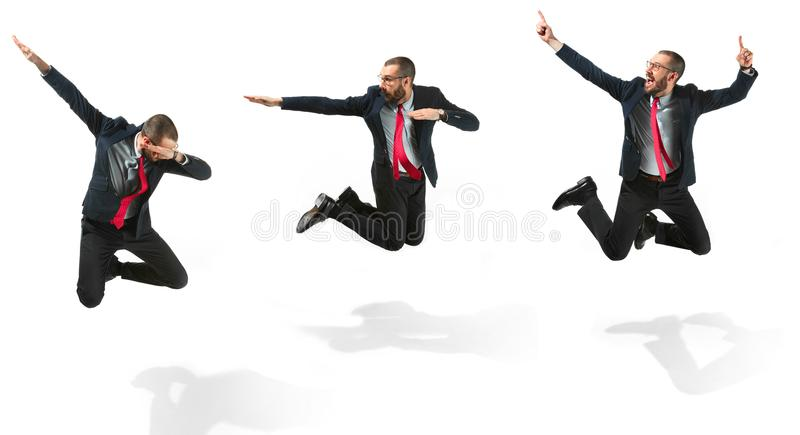 Funny cheerful businessman jumping in air over white background stock images