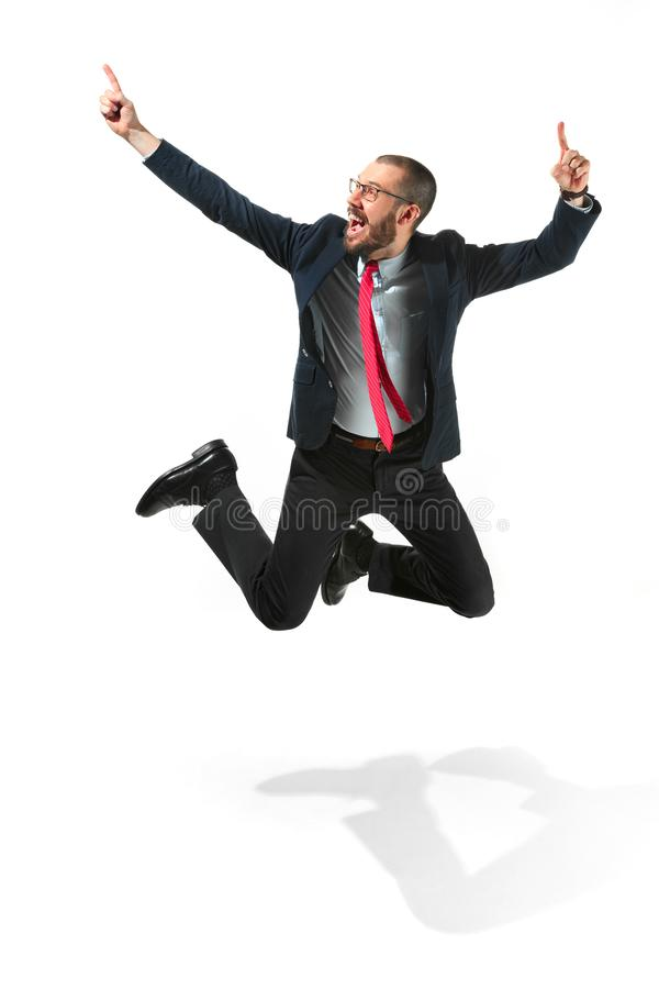 Funny cheerful businessman jumping in air over white background royalty free stock photos