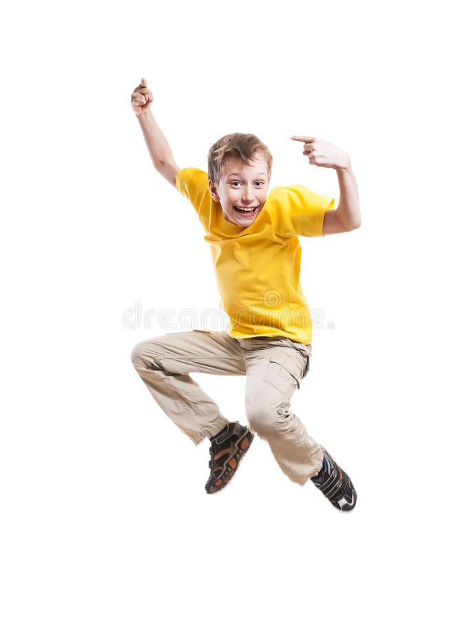 Funny cheerful child jumping and laughing pointing with his index finger stock photos