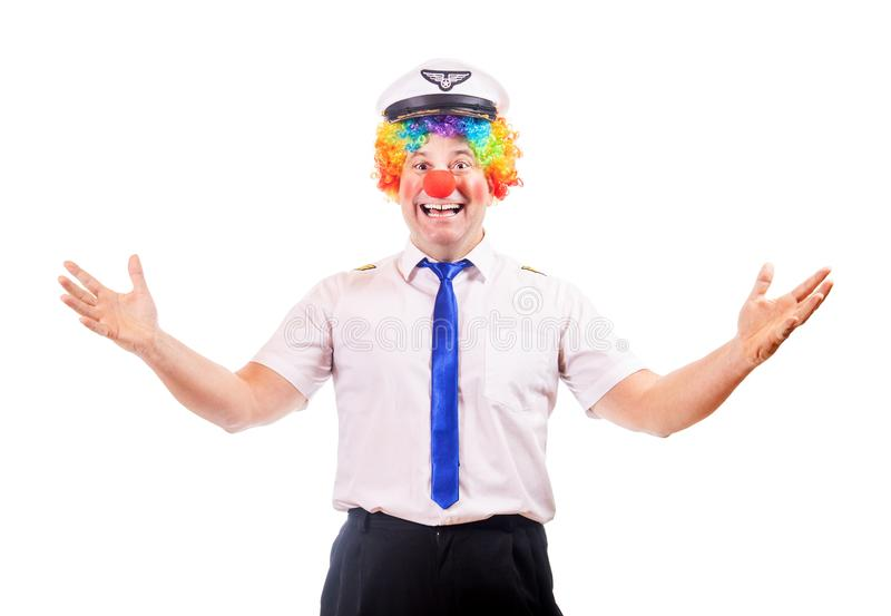 Funny cheerful pilot in clown costume stock photography