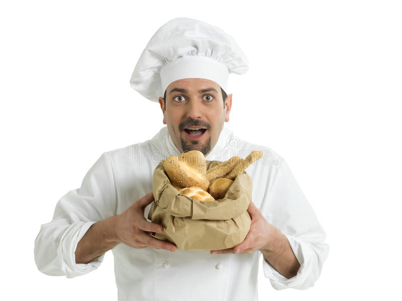 Funny chef with Italian bread. A happy chef with white uniform and a bag of various breads royalty free stock photography
