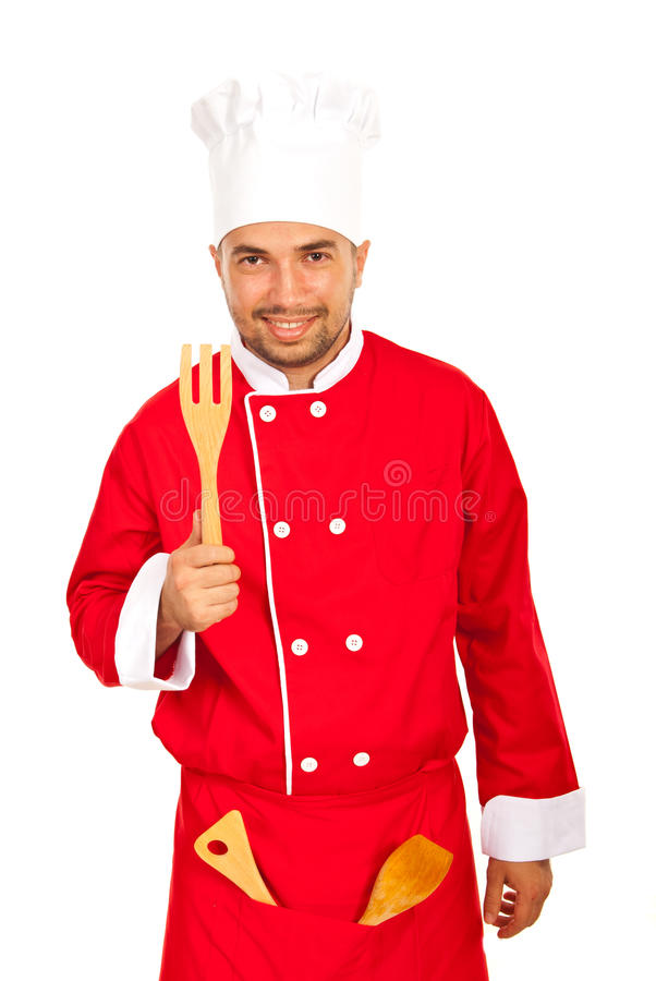 Funny chef showing wooden utensils. Funny chef showing wooden utensil isolated on white background stock photography