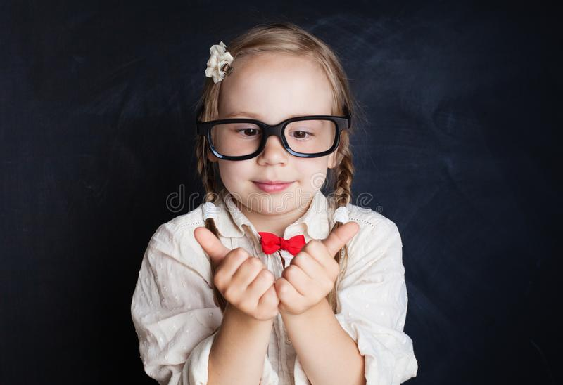 Funny child on blackboard background. Happy smiling girl royalty free stock photos