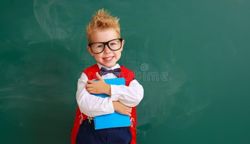 Funny child boy student about school blackboard stock photo