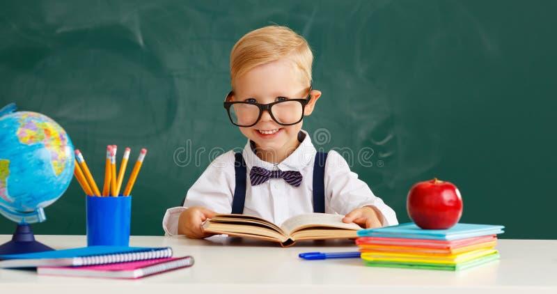 Funny child boy student about school blackboard royalty free stock photo