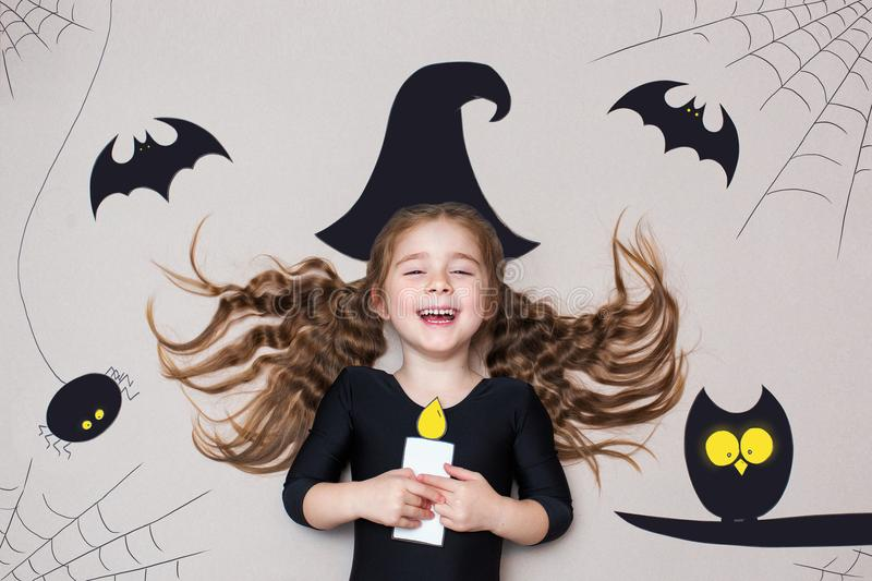 Funny child dressed witch costume. Halloween holidays concept stock image
