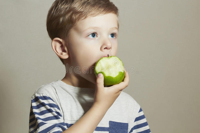 Funny Child eating apple.Little Boy. Health food. Fruits. Vitamin C stock images