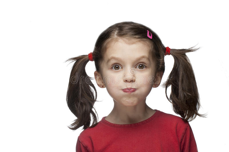 Funny child face stock images