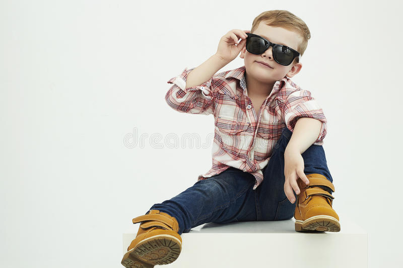 Funny child. fashionable little boy in sunglasses. stylish kid in yellow shoes. Fashion children royalty free stock images