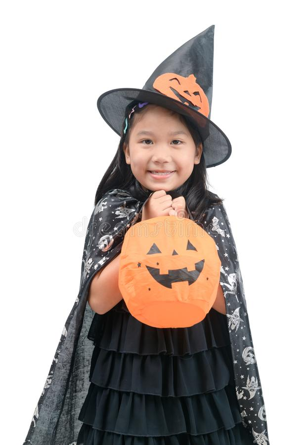 Funny child girl in witch costume for Halloween stock photos