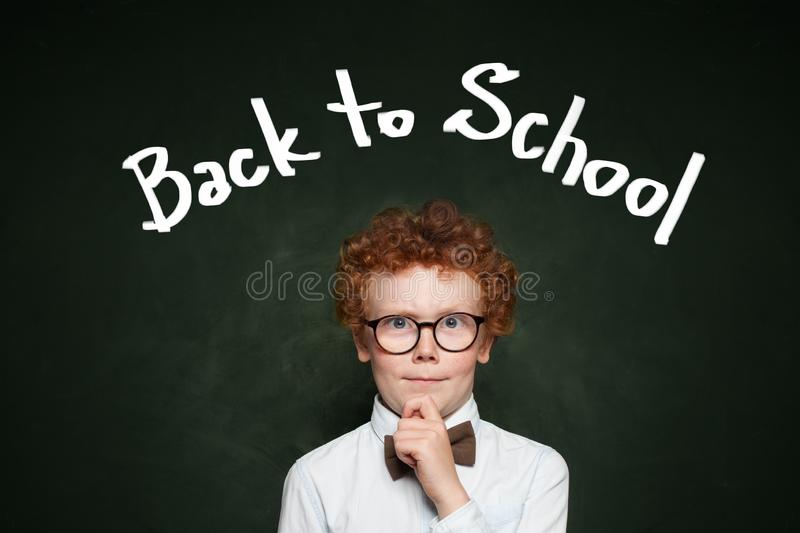 Funny child in glasses. Back to school concept royalty free stock photography