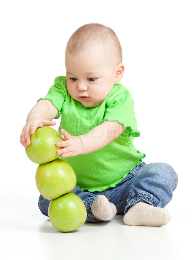 Funny child with green apples. Adorable child with green apples stock image