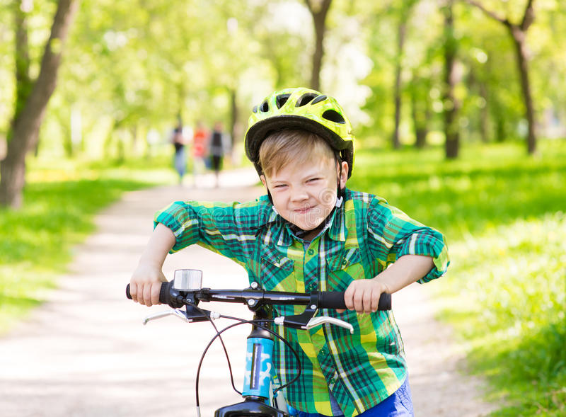 Funny child learns to ride a bike.  stock images