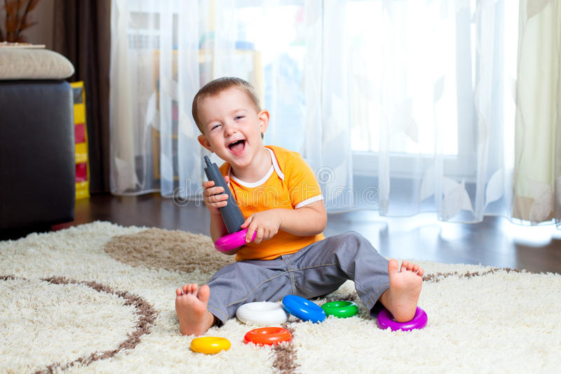 Funny child playing with color toy. Funny child playing with color pyramidion royalty free stock photo