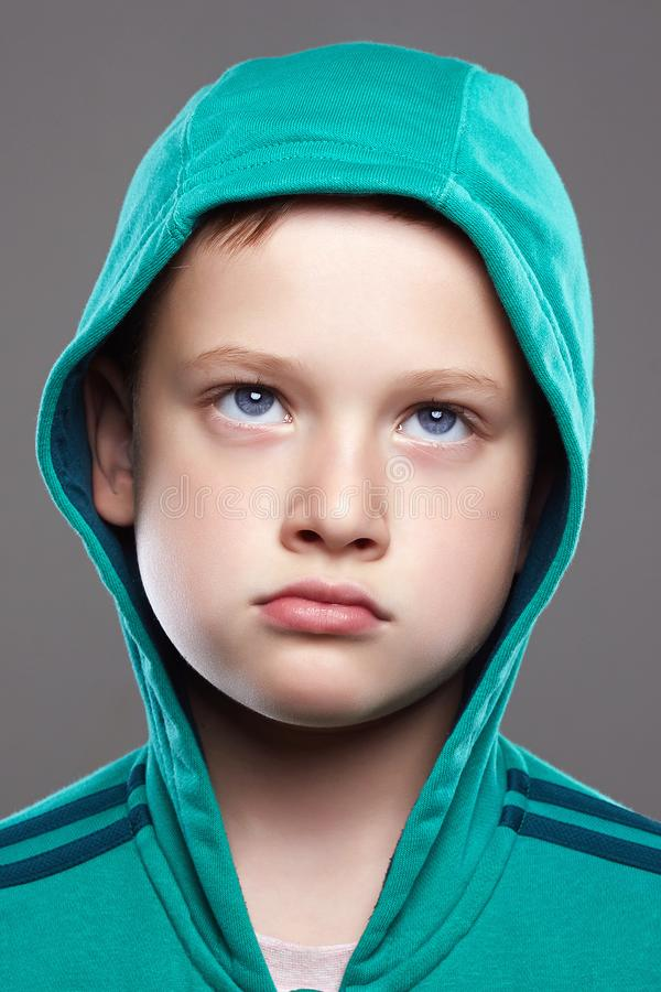 Funny child portrait. grimace emotion kid stock image