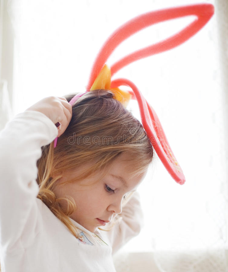 Funny child in rabbit ears stock photo