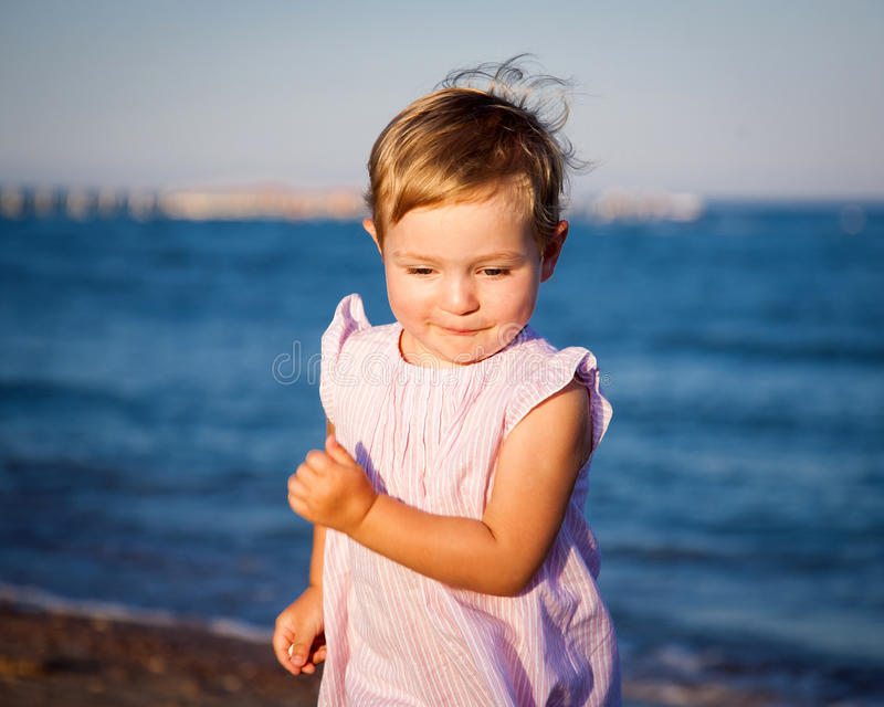 Funny child running. At the beach stock photos