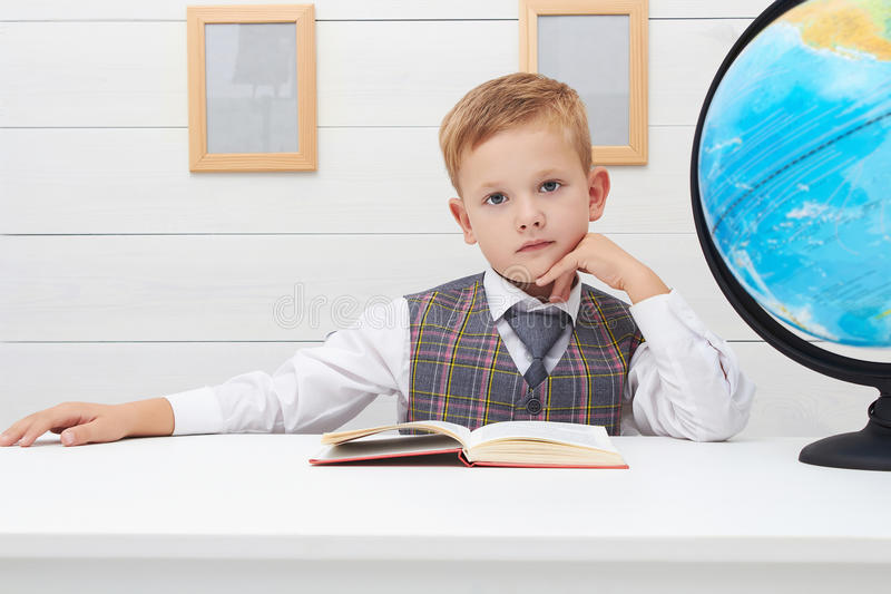 Funny Child in school.little boy with Book, Children Education. Fashion portrait stock photo