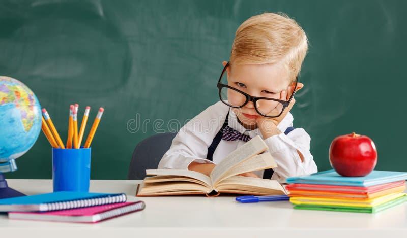 Funny child   schoolboy  boy student about school blackboard royalty free stock image