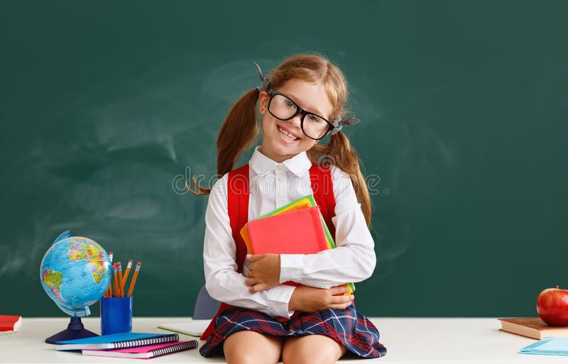 Funny child   schoolgirl  girl student about school blackboard. Funny happy child   schoolgirl  girl student about school blackboard stock photo