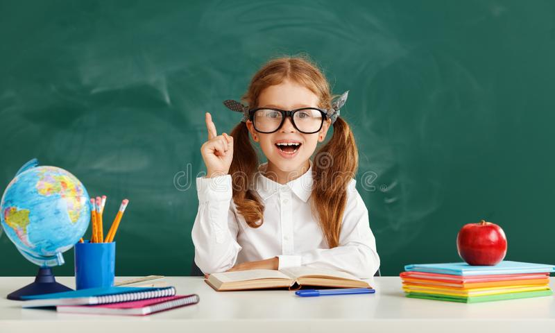 Funny child   schoolgirl  girl student about school blackboard royalty free stock image