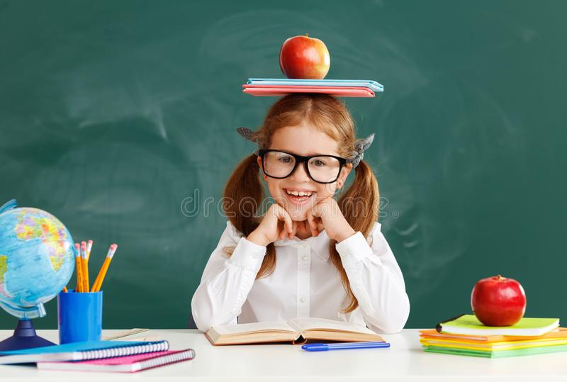 Funny child   schoolgirl  girl student about school blackboard stock images