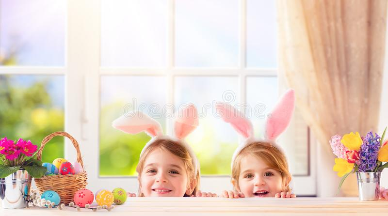 Funny Children With Bunny Ears Playing stock photo