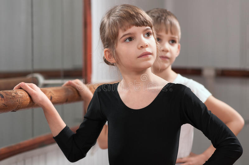 Children learn to dance in the ballet barre stock photos