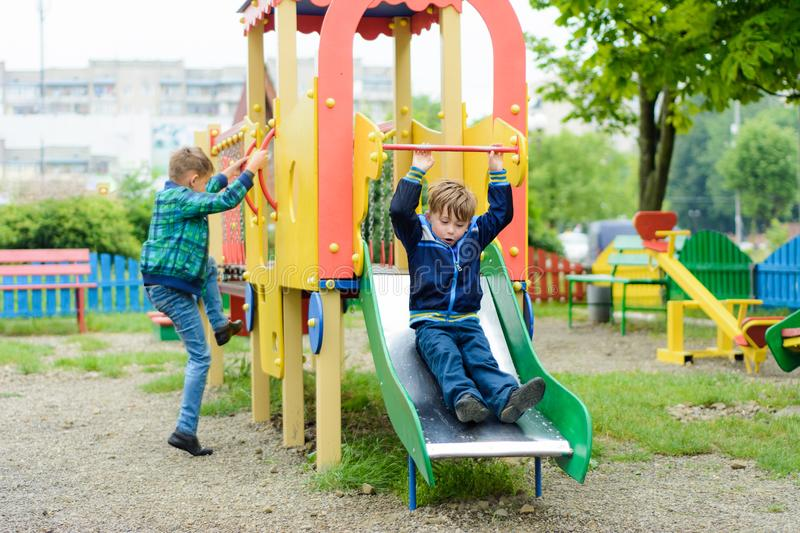 Funny children play on a children`s playground royalty free stock photo