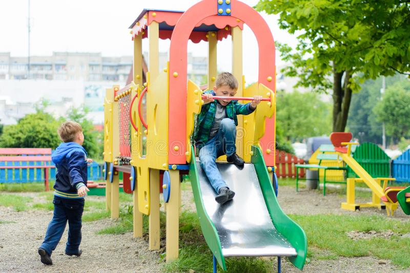 Funny children play on a children`s playground royalty free stock image