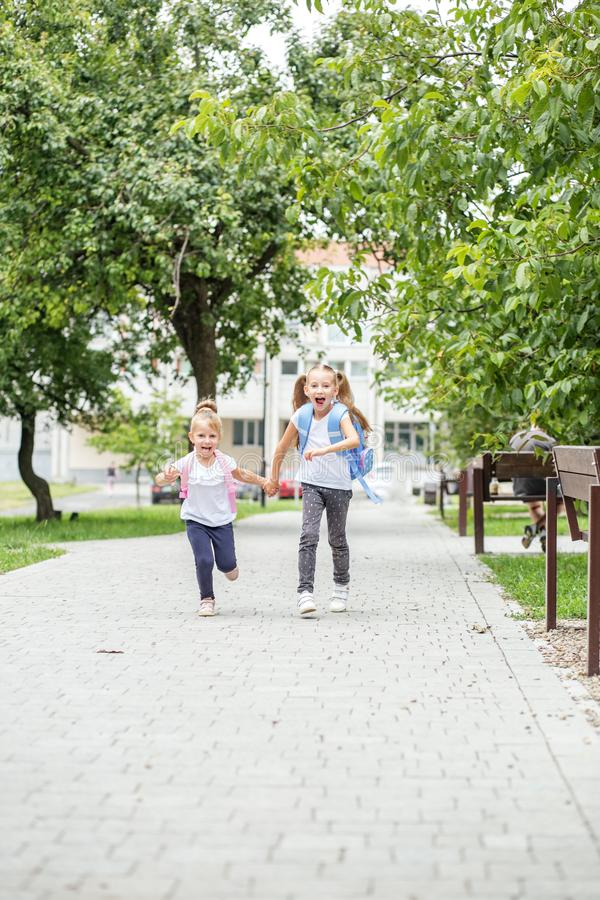 Funny children run to school. The concept of school, study, education, friendship, childhood. Funny children run to school. The concept of school, study royalty free stock photos