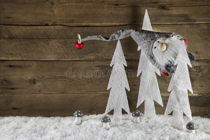 Funny christmas background of wood with snow and a santa hanging royalty free stock photos