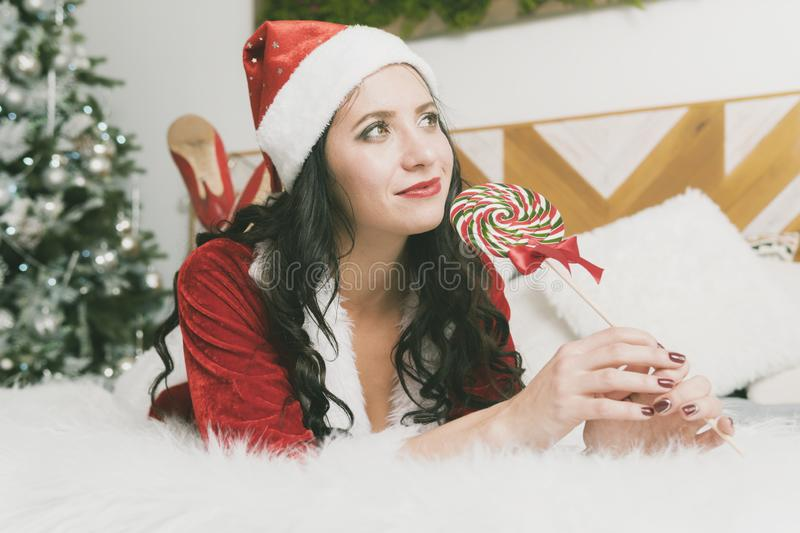 Funny Christmas Girl Holding Candy Lollipops. Beautiful expressive woman in sweet Christmas fantasy portrait with lollipops. Funny Christmas Girl Holding a Candy stock photography