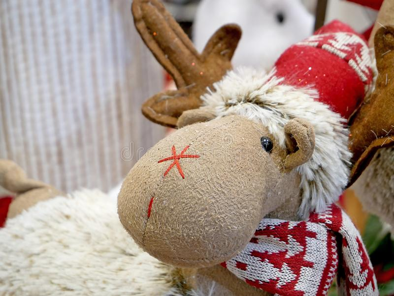 Funny Christmas reindeer in Santa hat. Time for Christmas Gifts royalty free stock images