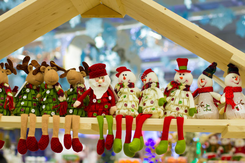 Funny Christmas snowmans, reindeers, Santa Claus. Christmas snowmans, reindeers and Santa Claus sit on shelf royalty free stock photo