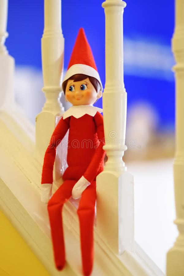 Funny Christmas toy elf on stairs stock image