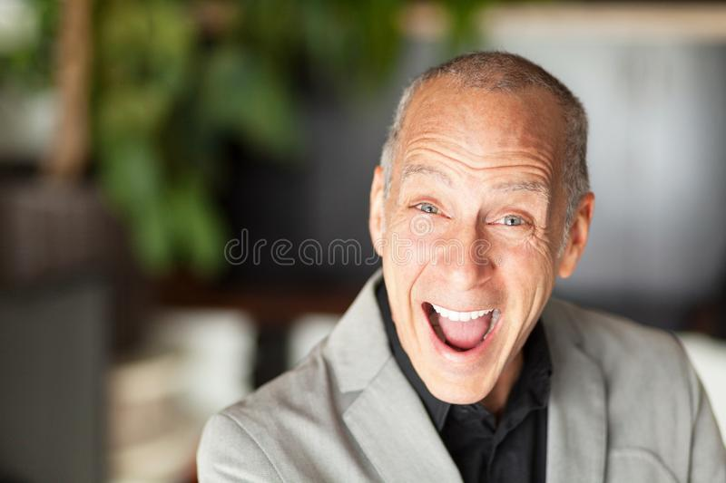 Funny classic grandfather. He is a elderly happy men royalty free stock image