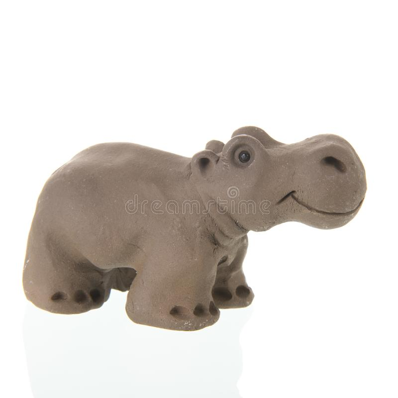 Funny clay Hippo. Isolated over white background stock photography
