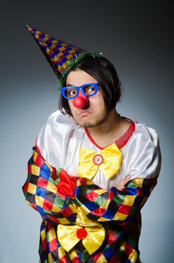The funny clown against dark background stock photos