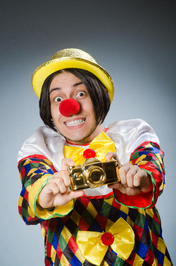 The funny clown against dark background. Funny clown against dark background royalty free stock photography