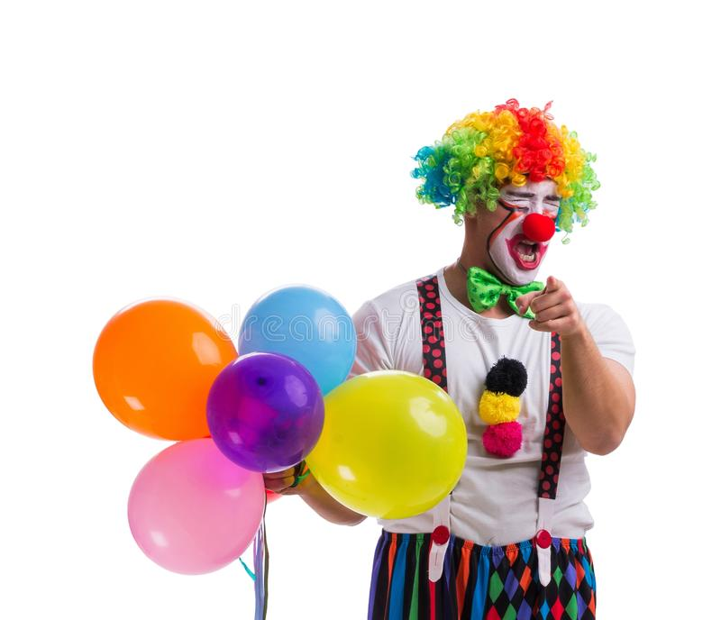 Funny clown with balloons isolated on white background. The funny clown with balloons isolated on white background royalty free stock photos