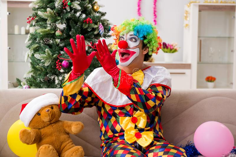 Funny clown in Christmas celebration concept. The funny clown in christmas celebration concept stock images