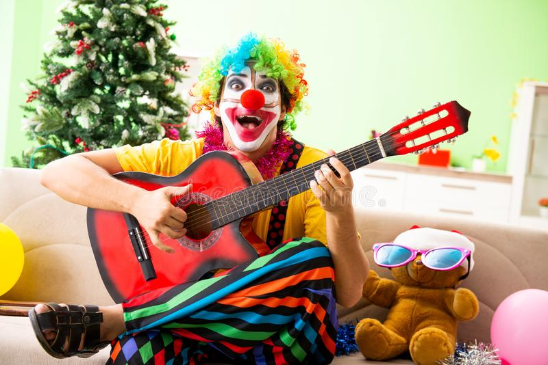 Funny clown in Christmas celebration concept. The funny clown in christmas celebration concept royalty free stock photo