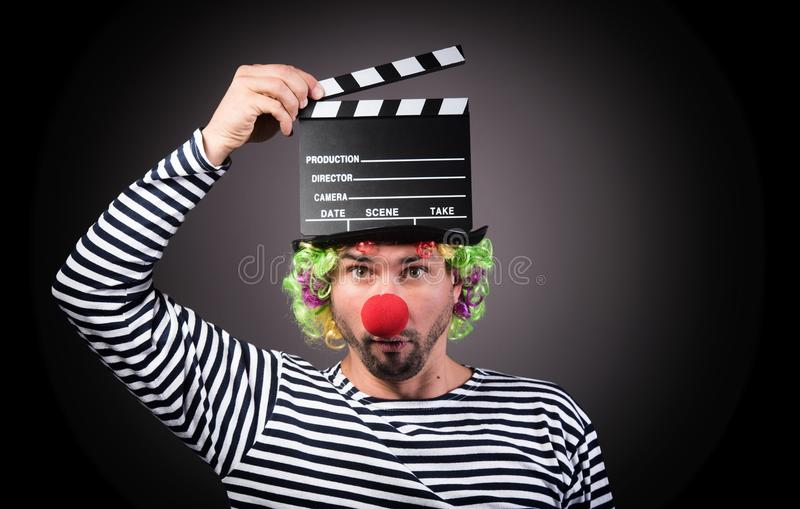 Funny clown with clipper box. royalty free stock image
