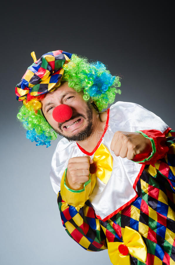 Funny clown in colourful. Costume royalty free stock image