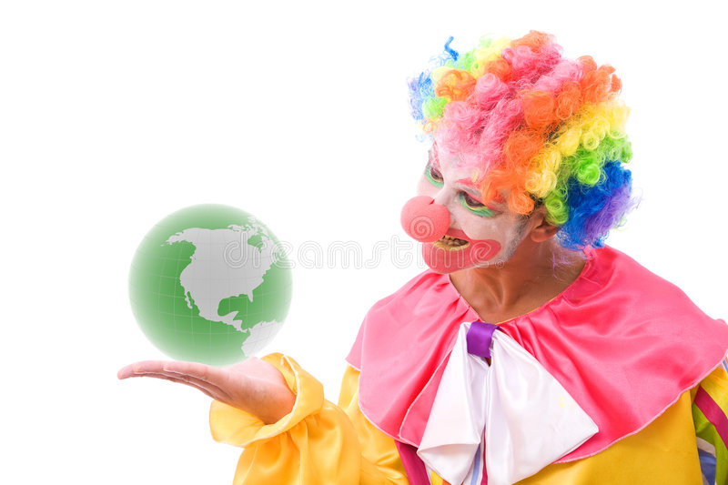 Funny clown with a green globe stock photography