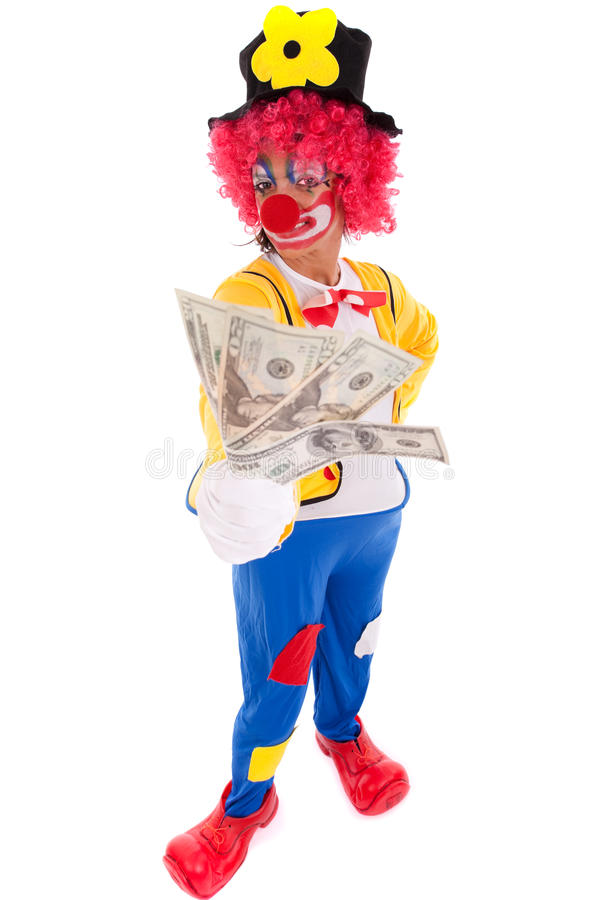 Funny clown holding money. Funny clown showing some dollar bills (isolated on whites stock photos