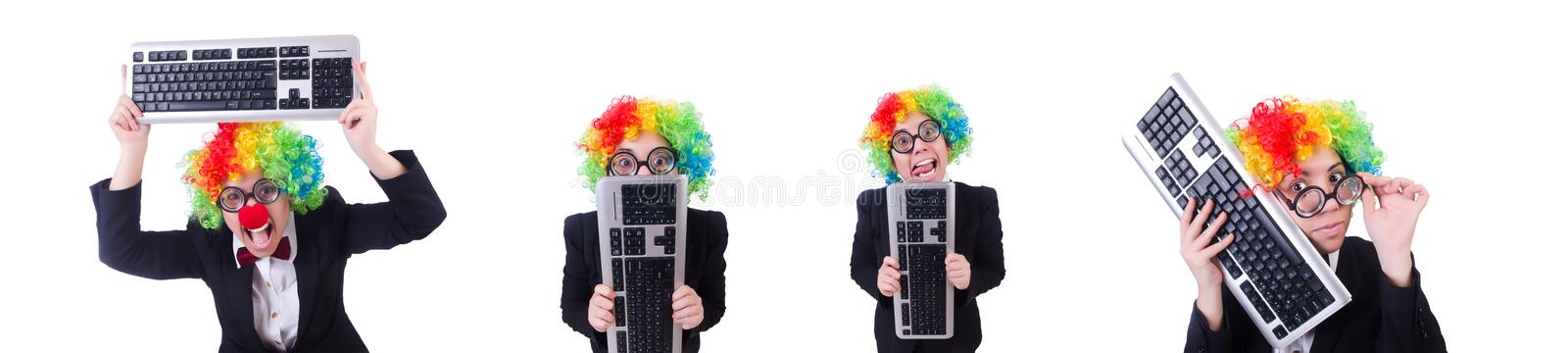 Funny clown with keyboard on white royalty free stock image