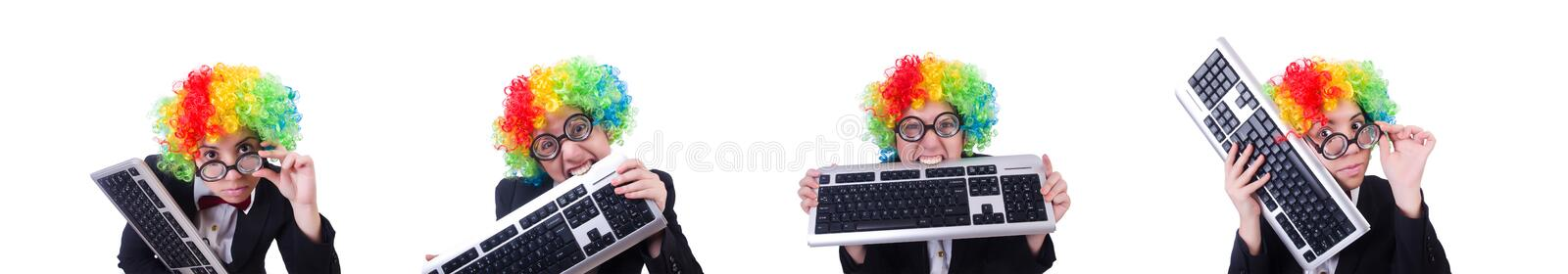 Funny clown with keyboard on white stock photos